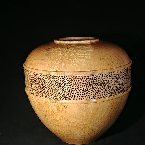 Pierced maple hollow form