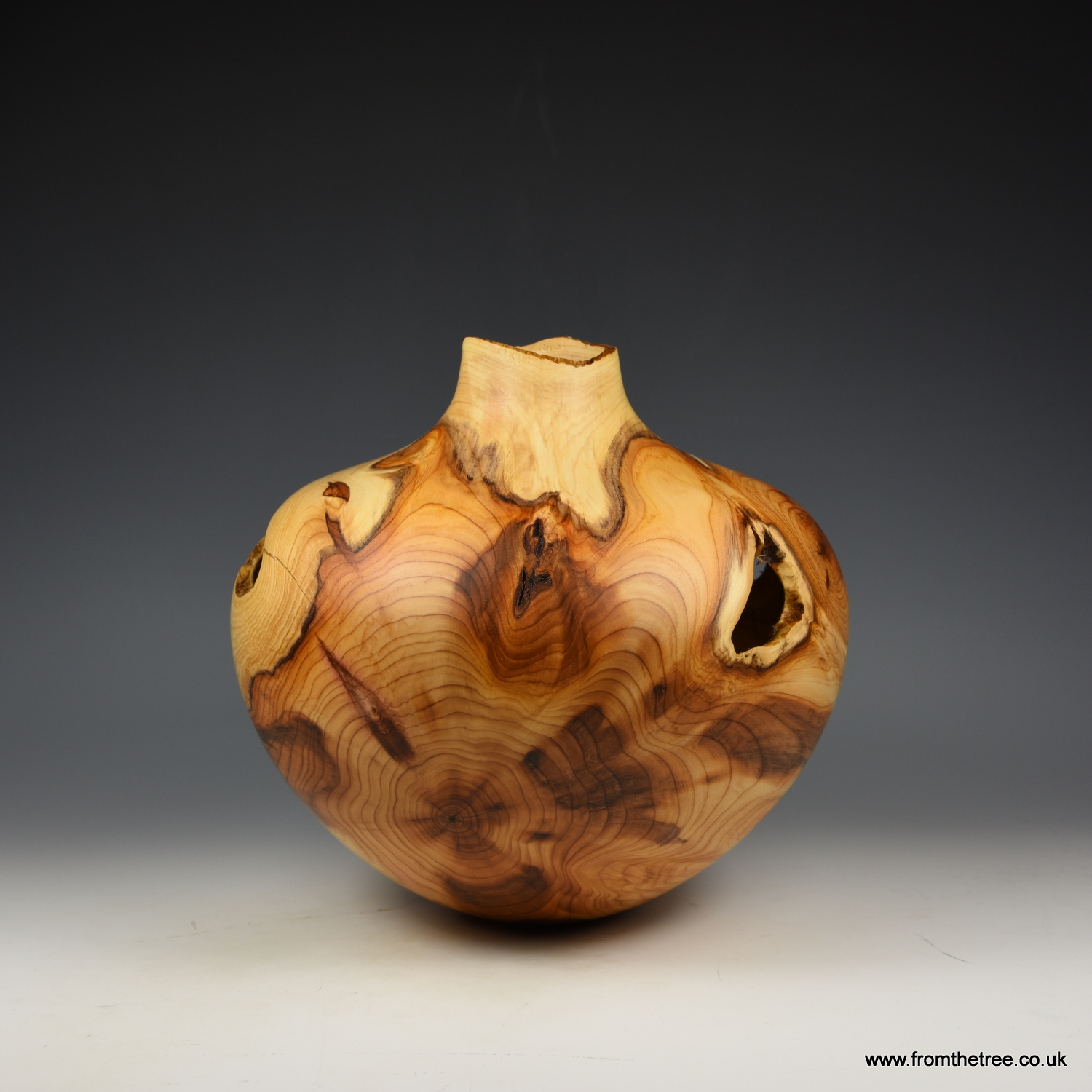 Natural edge yew hollow form